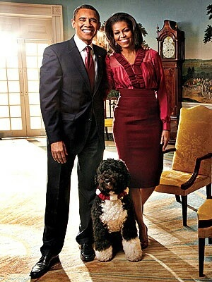 President Barack Obama and his wife Michelle Obama with their neutered male Portuguese Water Dog Bo.