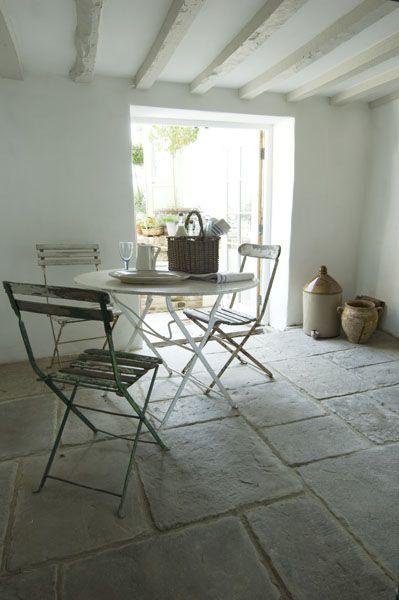 dining area simplicity with beautiful stone floors @carolinearber