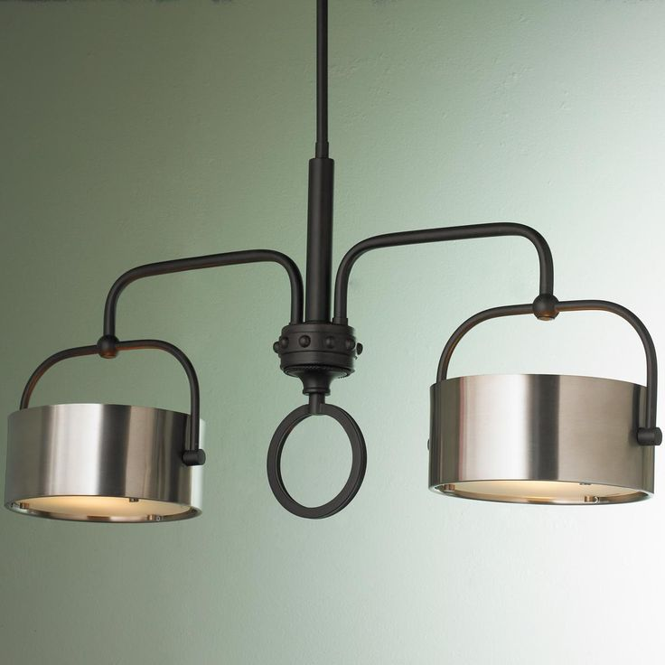 Bronze with Brushed Aluminum Drum Shade Chandelier This high style island chandelier combines antiqued brushed aluminum drum shades and a tubular dark bronze frame with rivet detailing for vintage industrial appeal.
