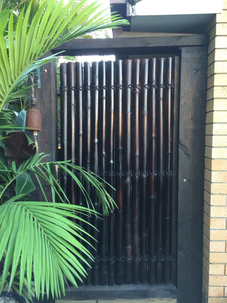 Black Bamboo Front Gate - setting the tropical jungle theme from the very start. A coat of Black Japan stain every year keeps it looking sharp.