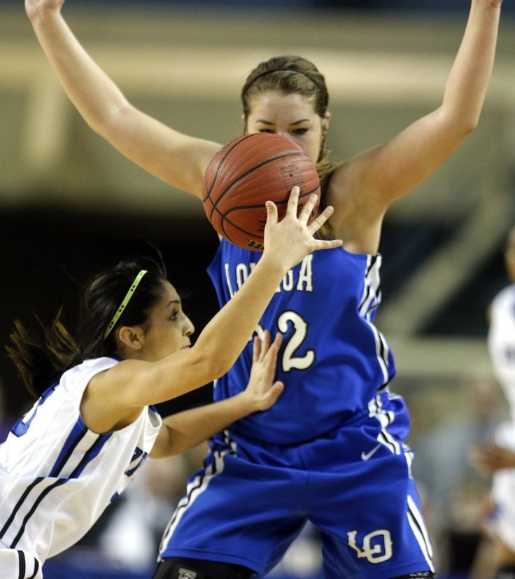 Coyle's Alicia Maker falls as Lomega's Rachel Yost defends during the Class B girls high school basketball championship game between Lomega and Coyle at the Jim Norick Arena, aka The Big House, at State Fair Park in Oklahoma City, Saturday, March 7, 2015. Photo by Sarah Phipps, The Oklahoman