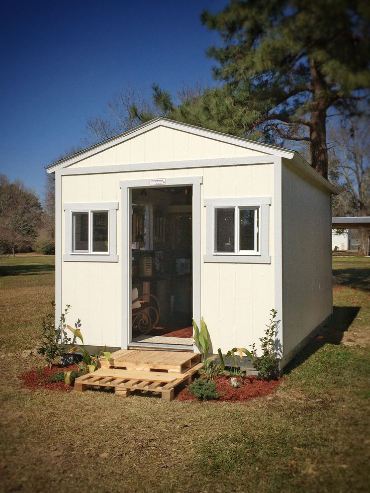 such a cute little backyard shed those pallet front steps are a work of genius