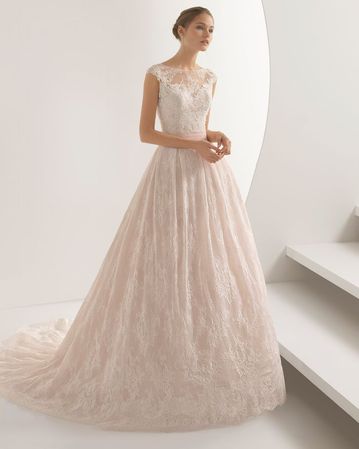 Princess-style beaded lace wedding dress with illusion neckline and closed back, in rose and natural. 2018 Rosa Clará Collection.