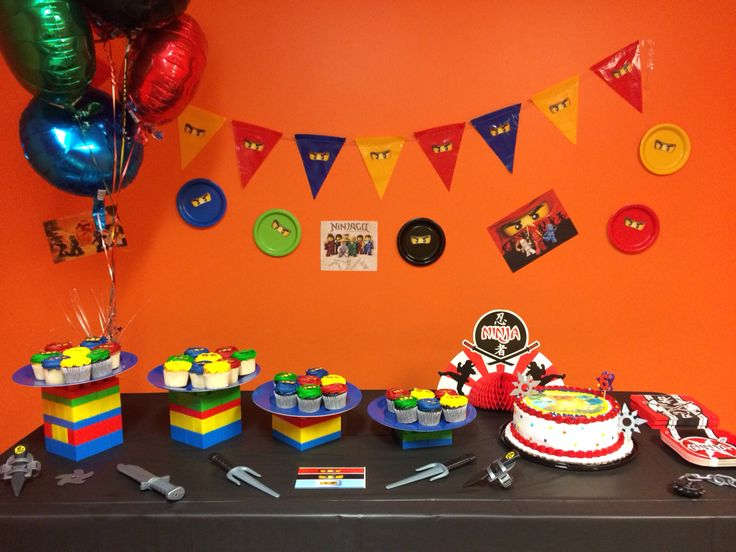 Lego Ninjago birthday! By Stephanie McVey I purchased the banner and then attached the Lego Ninjago eyes to each pennant. I found lots of free printable's for Lego Ninjago online. We made the towers out of Duplo Legos and placed plastic plates on top of them. Then added ninja weapons for table decorations!