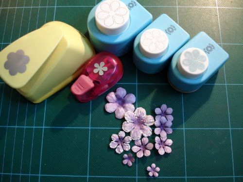 tutorial on making, shaping, coloring flowers made from punches.