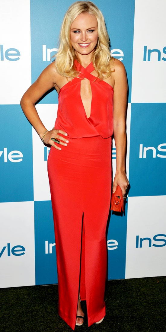 Akerman hit the carpet at the InStyle Summer Soiree in a high-slit Cushnie et Ochs halter dress, a leather Coach clutch, elongated cocktail ring and black Tibi sandals.
