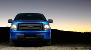 F-150 STX in Blue Flame Metallic. STX sports a black grille with body-color surround.