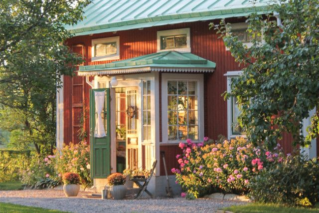 Beautiful porch, traditionally red Swedish cottage in the countryside.