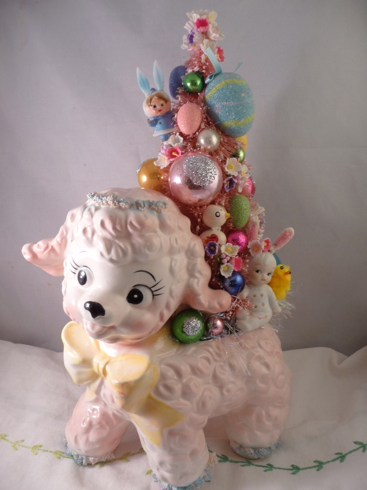Vintage lamb planter with bottle brush tree decorated with vintage ornaments.