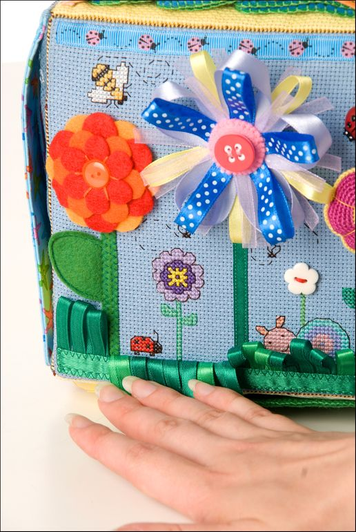 #8 Ribbon/grass flowers with hidden bugs. Like flowers of differing materials. Counted cross stitch interesting idea