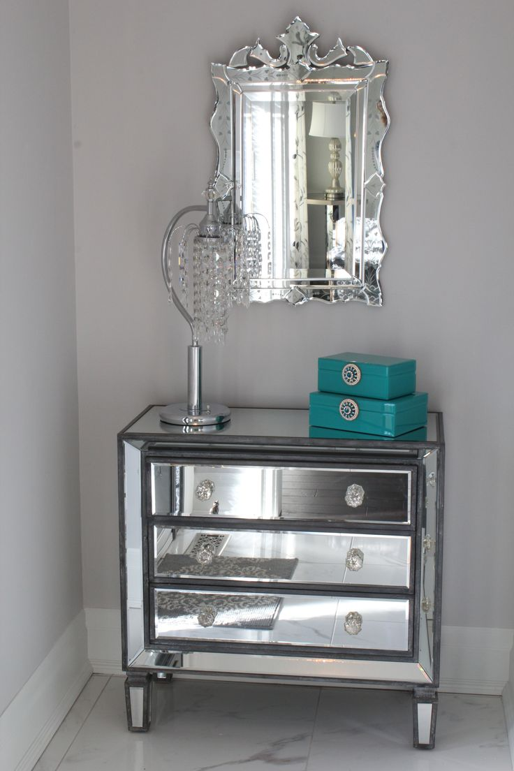 Making a beautiful statement in a small front entrance with this mirrored chest and Venetian look mirror