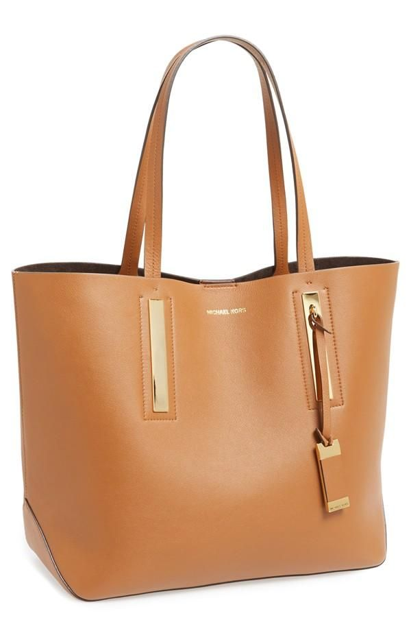 Adore the sophistication of this Michael Kors leather tote.