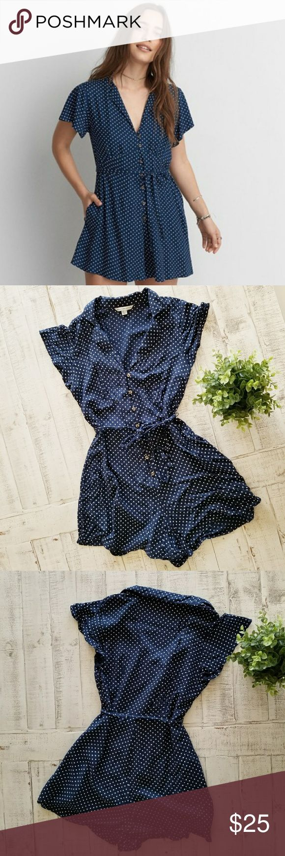 American Eagle Polka Dot Romper with Pockets Adorable American Eagle navy with white polka dots romper! This is so cute and so soft! Perfect by itself, with a cardigan, heels, or sneakers! It just works with any occasion! Two pockets one on each side, elastic and button closure, and tie waist. Great condition no holes or tears!  *measurements are approximate  Pit to pit when full buttoned: 16.5 inches  Shoulder to hem: 29.5 inches Sleeve: 6 inches Inseam: 2.5 inches American Eagle Outfitters…