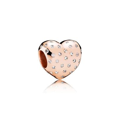Embellished with 74 sparkling flush-set stones and now available in a romantic rose colour created from a unique blend of metals, this classic heart charm is an endearing token of love and appreciation. Purchase this romantic charm in concept stores or online. Please note: SALE product will be packaged in a plush black velvet pouch.
