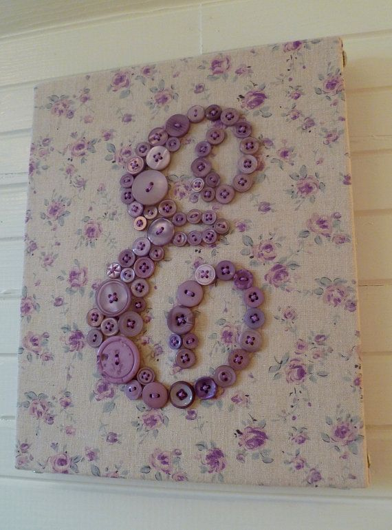 fabric-covered canvas with button letter, love button art