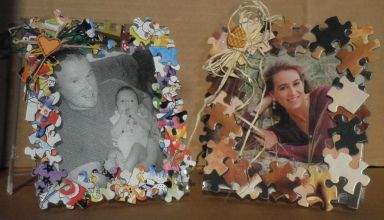 Picture frame out of old CD case and puzzle pieces.