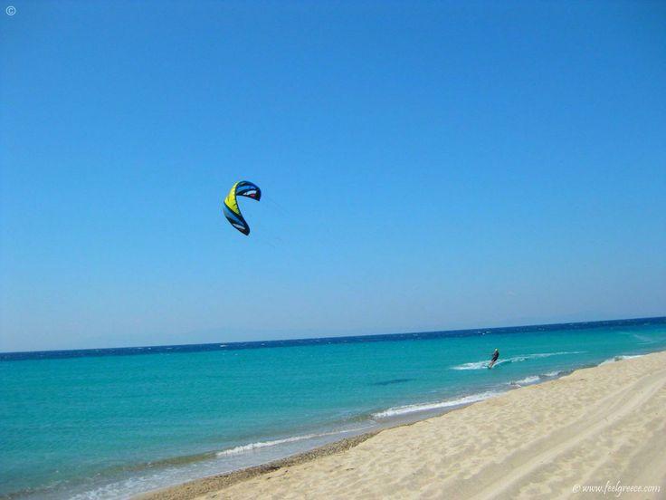 The lonely kitesurfer in Possidi - beach with sandy cape on the west coast - Kassandra