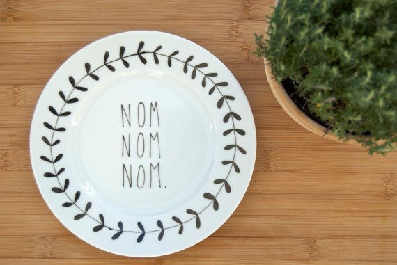 Fav noise for culinary appreciation: Illustrated NOM NOM NOM plate with leafy wreath by ohNOrachio, £25.00