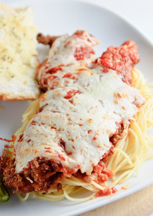 Veal Parmigiana Skillet fried veal cutlets with mozzarella cheese and tomato sauce.An excellent Italian recipe!