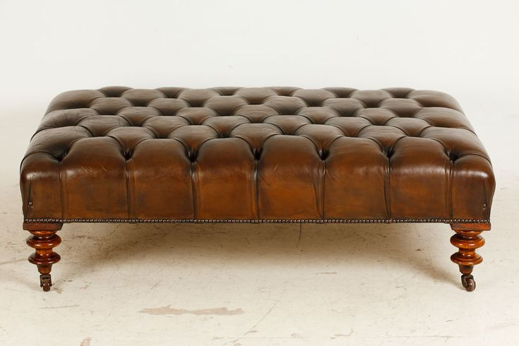 This large deep buttoned brown leather stool is a really great size & it can also be used as a coffee table, because the top is flat. The leather has lots of character, because it's hand coloured. The turned feet are mahogany, with brass casters. The feet are antique & the rest of it has been adapted into a stool. This is a great item with loads of character & a most useful piece too.