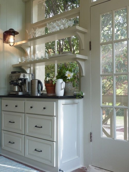 These kitchen shelves over windows are just gorgeous!  Love the white cabinets and the bright light!