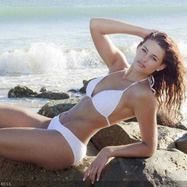 Rolene Strauss, Miss World 2014, looks nothing less than a beach goddess in this all white bikini.