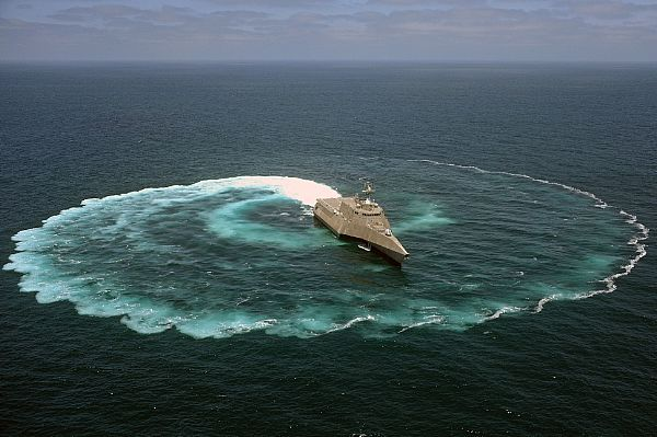 The littoral combat ship USS Independence (LCS 2) demonstrates its maneuvering capabilities in the Pacific Ocean off the coast of San Diego.