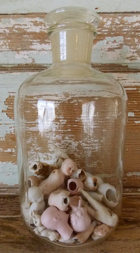 Porcelain German Doll Oddities Jar - One Of A Kind Decor  There are over 30 broken porcelain dolls from the 1800s in the bottom of my vintage glass