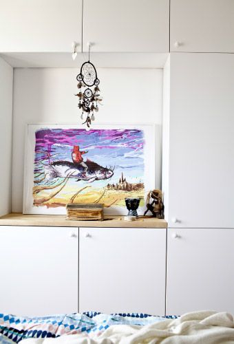 'We could have picked a wardrobe with sliding doors for this narrow space but most of our clothes fold away, so we decided to design storage using shallow METOD kitchen cabinets; they're perfect for us and so versatile for storing everything! Using cabinets allowed us to design the space in the middle where we can hang a TV at some point.'
