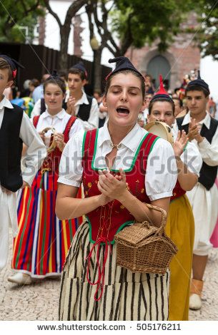 FUNCHAL, PORTUGAL - SEPTEMBER 2, 2015: Dancers with local costumes demonstrating a folk dance during the Wine Festival in Funchal on the Madeira, Portugal.