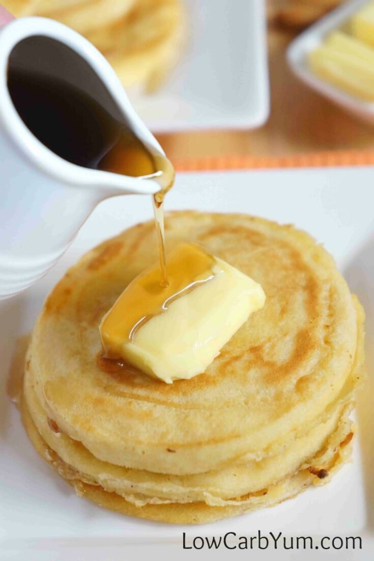 An easy recipe for fluffy gluten free low carb coconut flour pancakes. Such a tasty breakfast treat! Enjoy them with your favorite syrup or eat them plain. | LowCarbYum.com