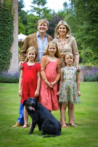 Dutch King Willem-Alexander, Queen Maxima, Princess Amalia (C), Princess Alexia (L) and Princess Ariane and their Labrador dog Skipper during a photo session at their residence Villa Eikenhorst in Wassenaar, The Netherlands, 19 July 2013