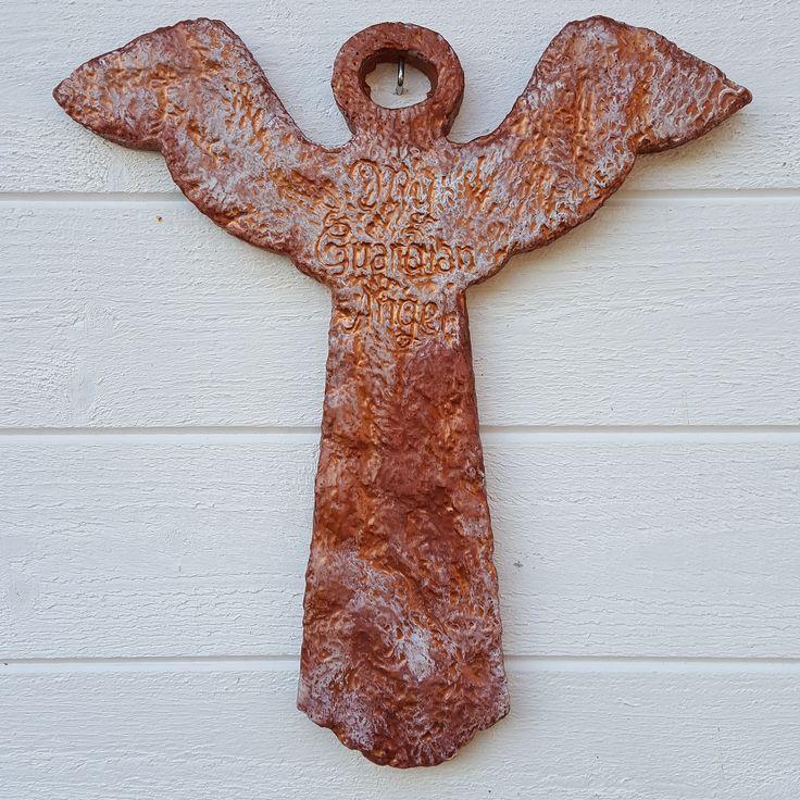 Betong engel,malt med vår kobbermaling og hvit patio paint.