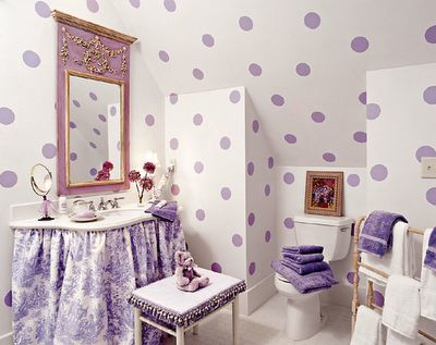 .Image from Southern Living - photo by Jean Allsopp  Large, lavender polka dots painted on crisp white walls is an easy and super cute idea. A toile skirt helps soften the vanity area. The tassel fringe and a lilac mirror add pizazz and important details to this girls bathroom.