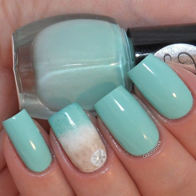 Next we have @royalpolish's Take Me To the Ocean, which is a dreamy mint creme! It shows quite blue here but is more mint green toned in real life. Shown is 3 coats with topcoat, which a little beach scene on the accent nail, partly inspired by @chalkboardnails. Be sure to follow Violet @royalpolish for availability!