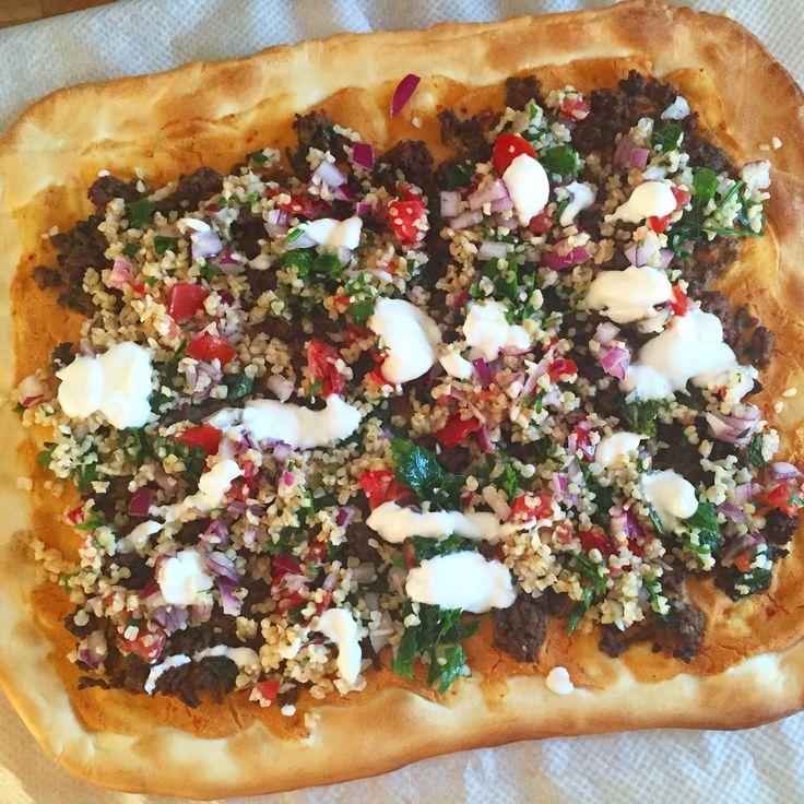 P I Z Z A with minced harissa meat, greek yoghurt, humus, bulgur, tomato, onion and mint!