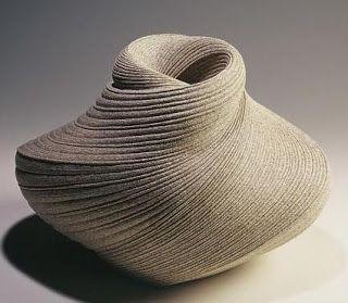 textured ceramic vessels are by artist Sakiyama Takayuki
