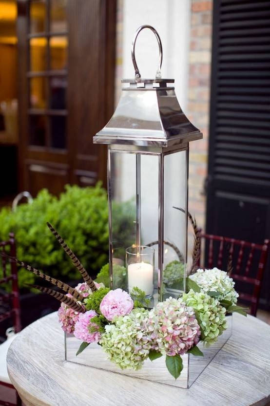 lantern centerpiece for outdoor tables~ lovely pop of spring with the hydrangeas