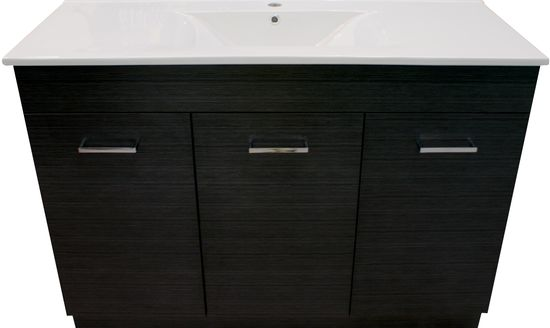 Alpha Paris 1200mm Single Bowl Woodgrain Vanity  This dark woodgrain Alpha Paris vanity will make your bathroom standout from the rest. The woodgrain has a  fine silver emboss and square handles on the doors. The slimline top is made out of high quality vitreous china with a square wave bowl. Nothing says design more than this vanity range.