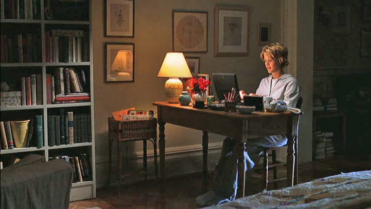 """""""You've got Mail"""" apartment, desk area in front of windows and bed"""