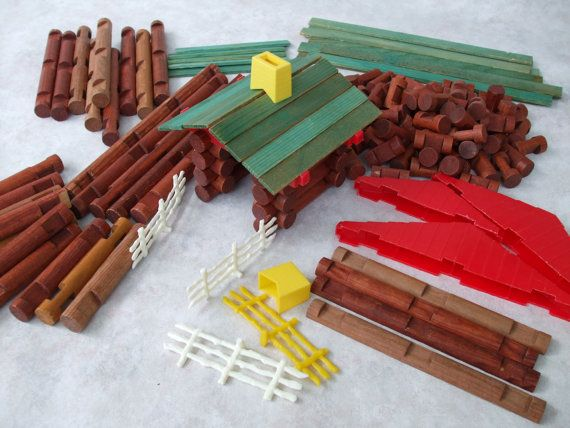 Lincoln Logs - This looks like the set we had, multiple pieces inherited, old mixed with new, always a few that were slightly discolored, and could never figure out why the chimney was yellow . . . gosh, this sure brings back memories.