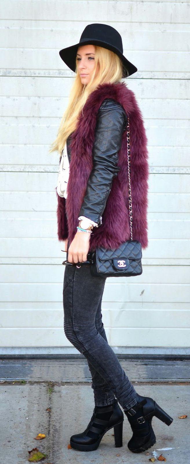 Charlotte Schouten is wearing a burgundy faux fur vest from Seven Sisters