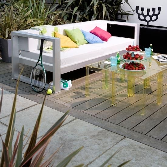 Mix and match decking - Get an ultra-modern look by mixing wooden decking with concrete and natural stone.
