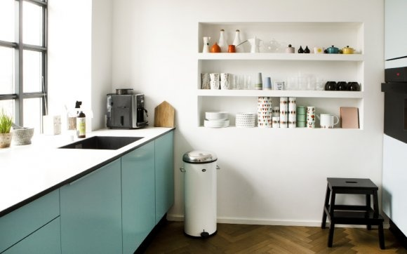 The colour on the cabinets and the built-in shelves are enviable