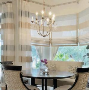 semi-sheer wide stripe draperies and Roman shades