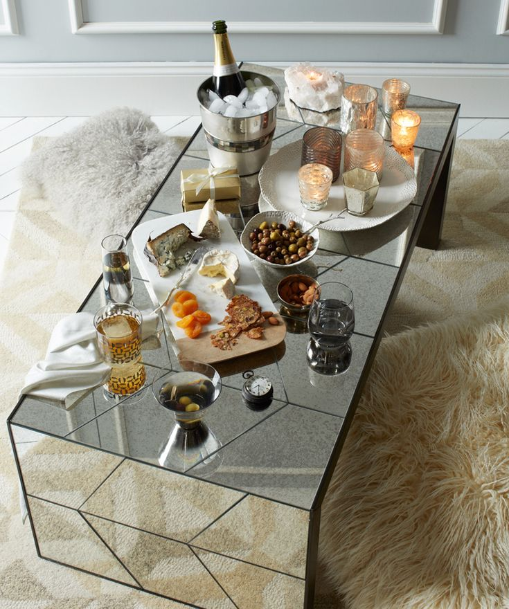 No windows in your living room?     Mirrored furniture and accessories – like this Herringbone Mirror Coffee Table – are an alternative way to reflect light + add a little glamorous detail.""