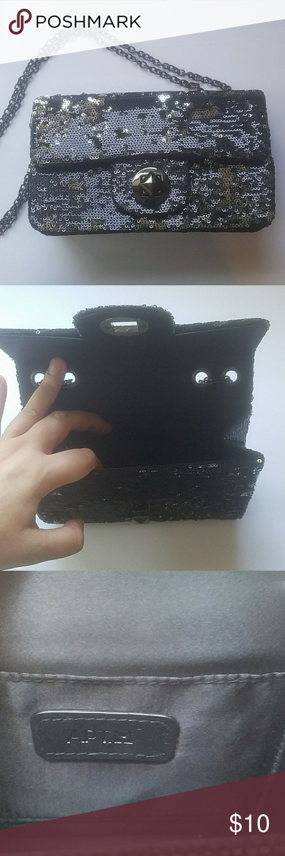 Black silver mermaid sequin handbag purse evening 🍀will accept all reasonable offers 🍀quick shipping 🍀open to bundling discounts 🍀no trades  Black and silver mermaid sequin purse. Could be an every day or a special occasion bag. Handle is chain, and you can have it as shoulder bag or longer like a waist or crossbody bag depending on how you adjust the chain handle. Apt 9 brand, never carried. Apt. 9 Bags Shoulder Bags