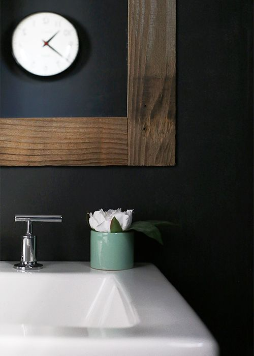 A foolproof, simple DIY mirror frame made from Stikwood to clothe all those frameless mirrors.