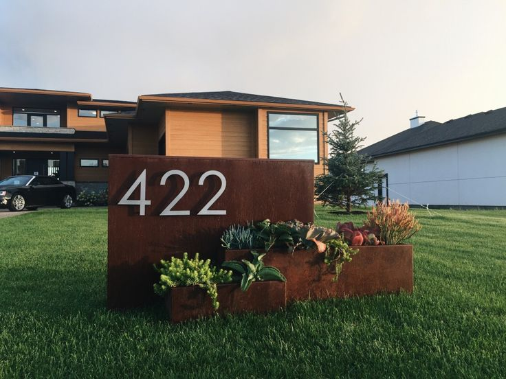 Metal address marker and tiered planter bed