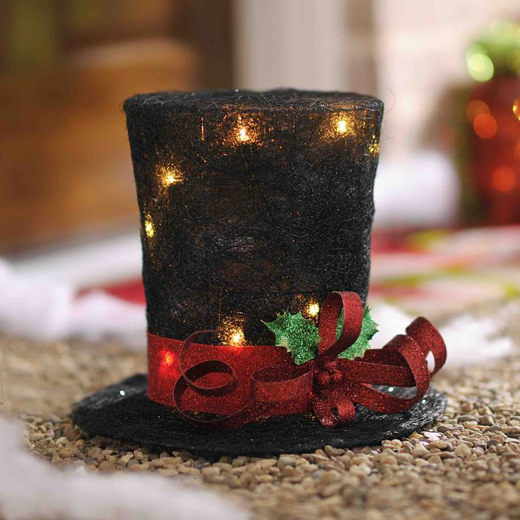 Make your Christmas magical this year with novelty lighting like the 'Pre-Lit Black Sisal Top Hat.' Watch as guests tip their hats to your holiday decorating style and enjoy the season to its full potential with the help of Kirkland's.
